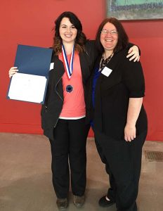 Melissa Cole with award and Sheryl Vanselow